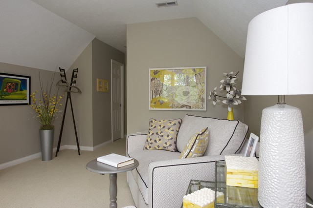 Example of a transitional family room design in Indianapolis with gray walls and a tv stand