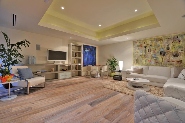 Family room - contemporary open concept beige floor family room idea in New York with beige walls and a tv stand
