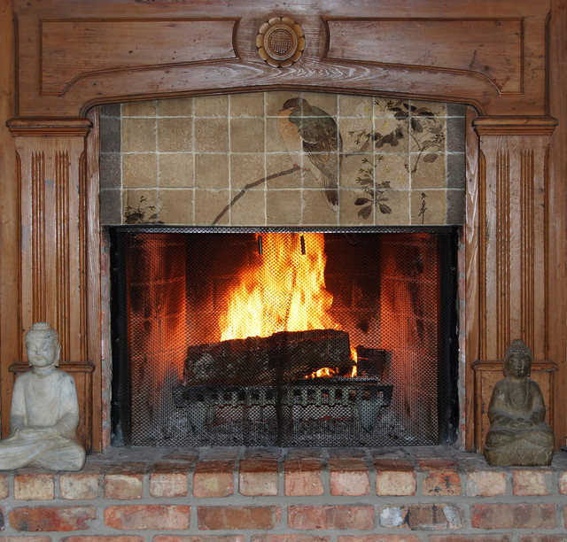 Asian tile mural above fireplace asian family room