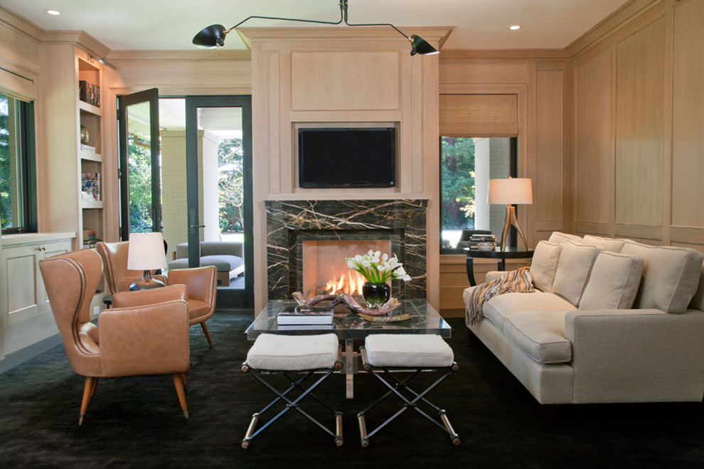 Mid-sized trendy open concept carpeted family room library photo in San Francisco with beige walls, a standard fireplace, a wall-mounted tv and a stone fireplace