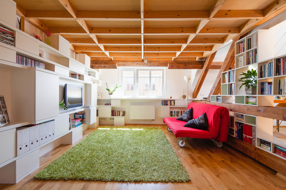 Eclectic medium tone wood floor family room photo in Other with white walls and a wall-mounted tv