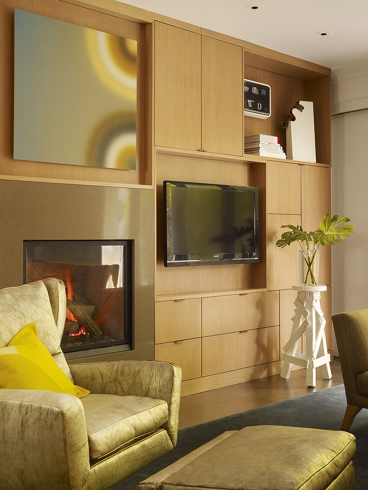 Inspiration for a contemporary family room remodel in San Francisco with a standard fireplace and a wall-mounted tv