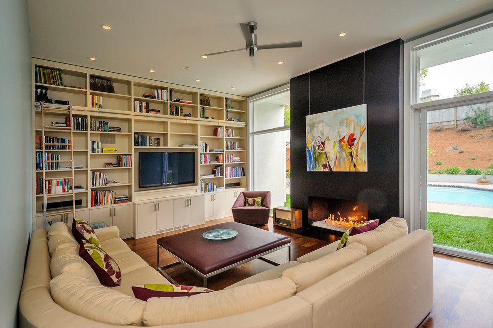 Inspiration for a contemporary family room library remodel in San Francisco