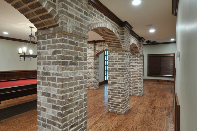 Basement With Brick Arches Traditional Family Room