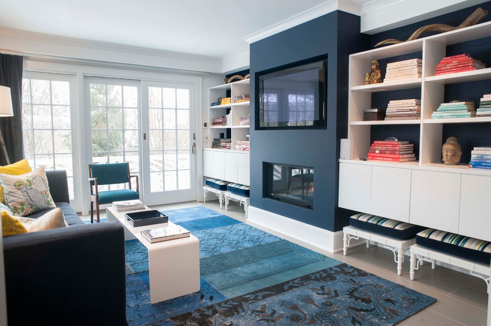 Example of a mid-sized beach style open concept porcelain tile family room library design in Other with white walls, a standard fireplace, a plaster fireplace and a wall-mounted tv