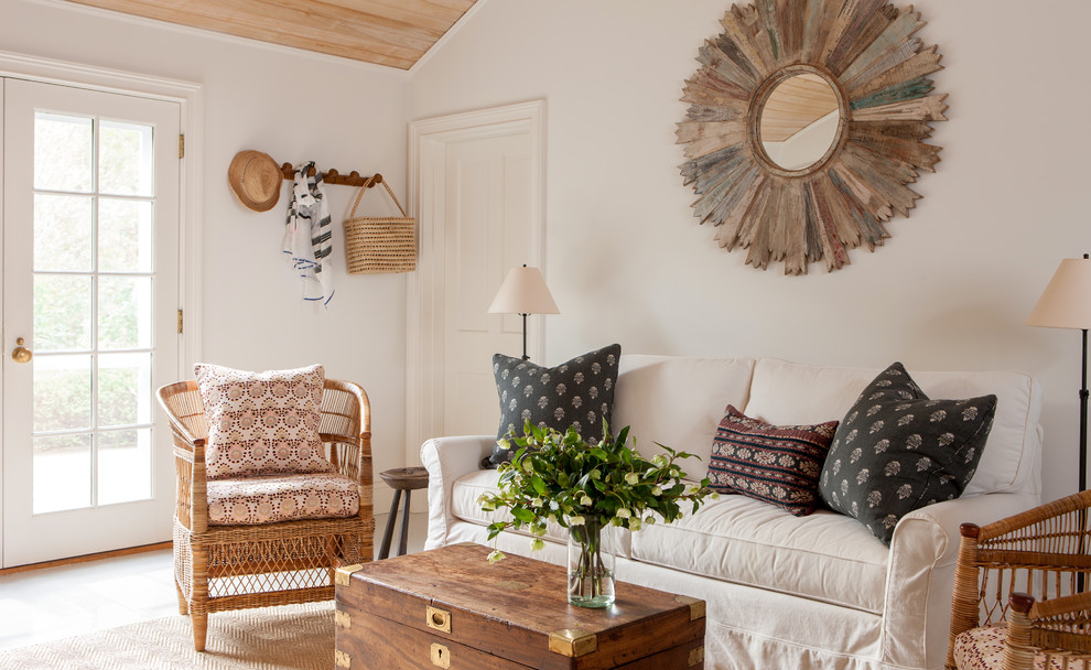 Family room - mid-sized coastal family room idea in Other with white walls