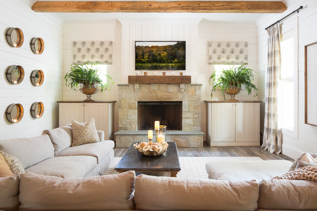 Example of a large cottage dark wood floor family room design in Atlanta with white walls, a standard fireplace, a stone fireplace and a wall-mounted tv