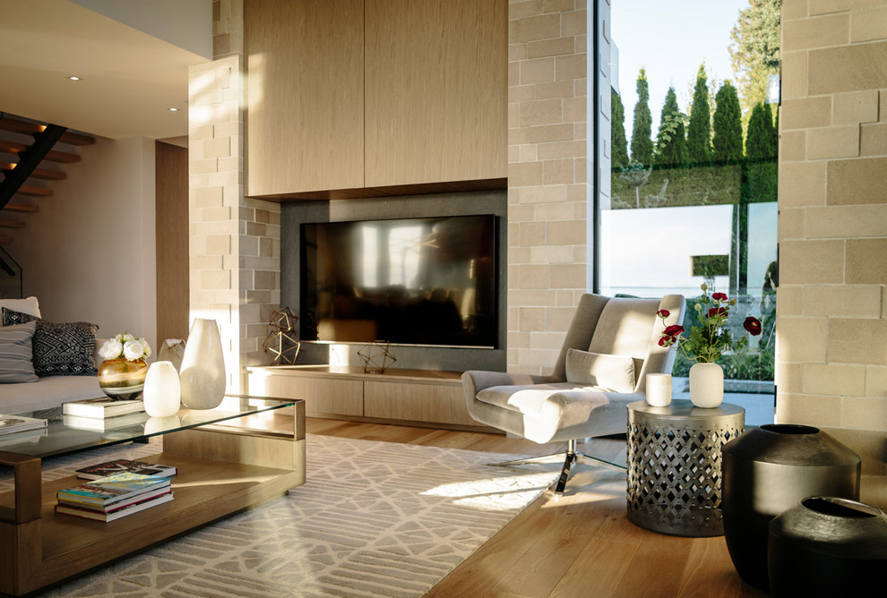 Inspiration for a large contemporary open concept medium tone wood floor family room remodel in Vancouver with a wall-mounted tv