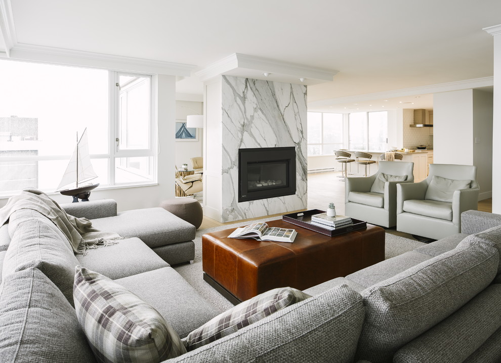 Inspiration for a mid-sized transitional open concept light wood floor family room remodel in Vancouver with white walls, a standard fireplace, a stone fireplace and no tv