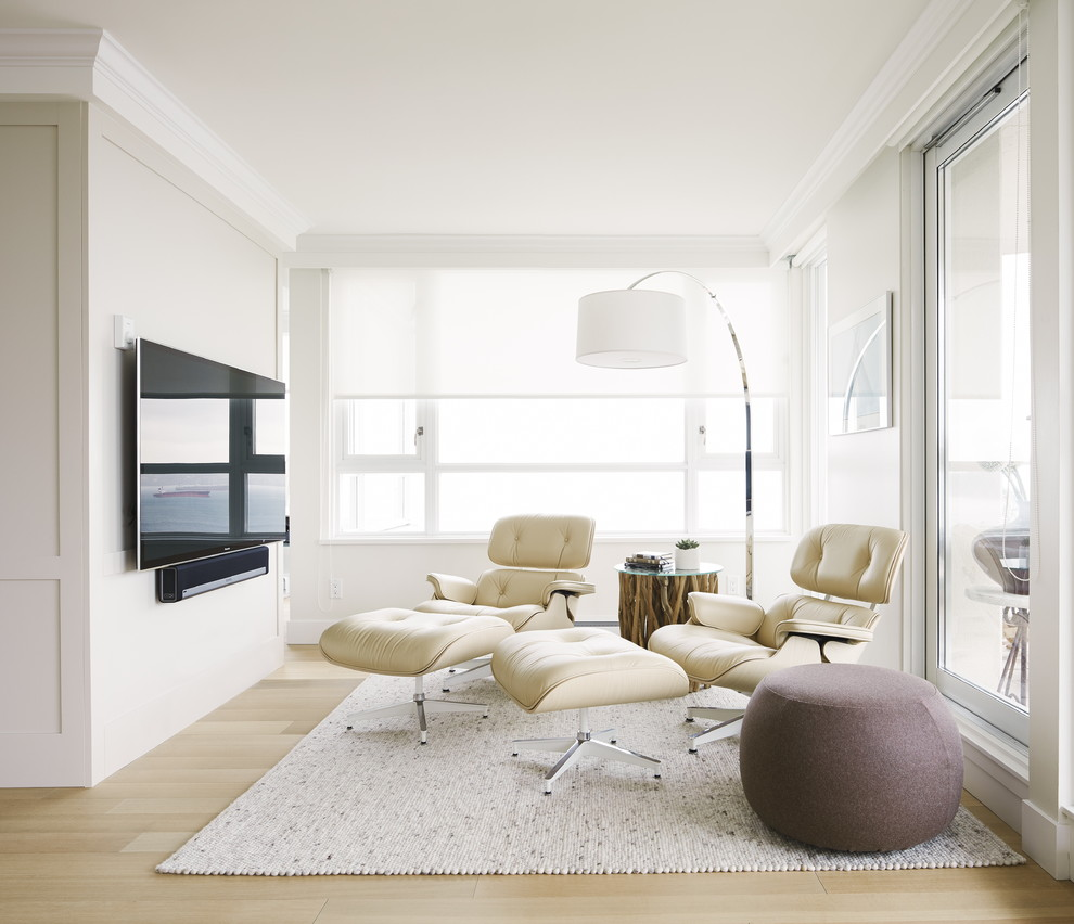 Inspiration for a small transitional open concept light wood floor family room remodel in Vancouver with no fireplace, white walls and a wall-mounted tv