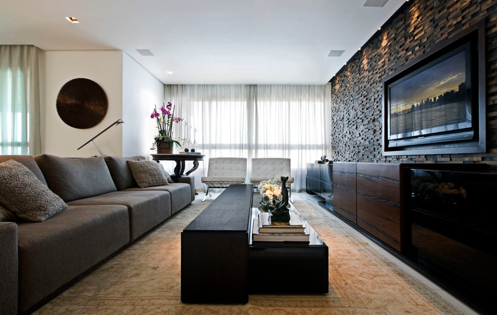 Family room - contemporary open concept family room idea in Other with a wall-mounted tv