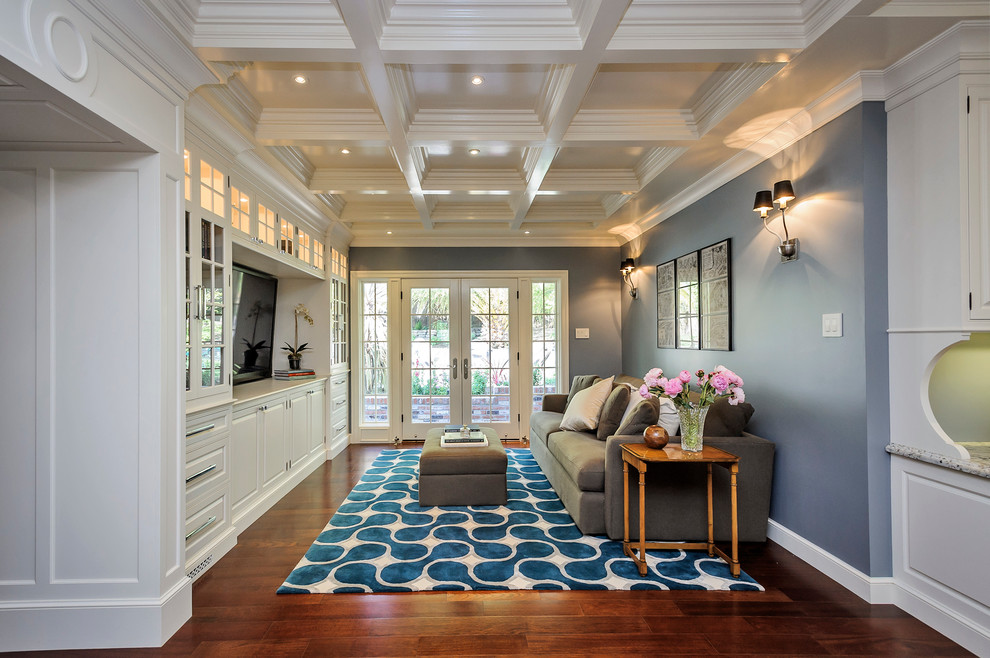 Mid-sized elegant enclosed brown floor and medium tone wood floor family room photo in San Francisco with blue walls, no fireplace and a media wall