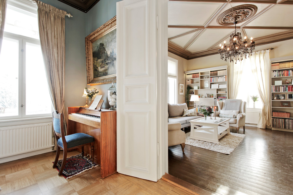 Example of a classic family room library design in Other with beige walls
