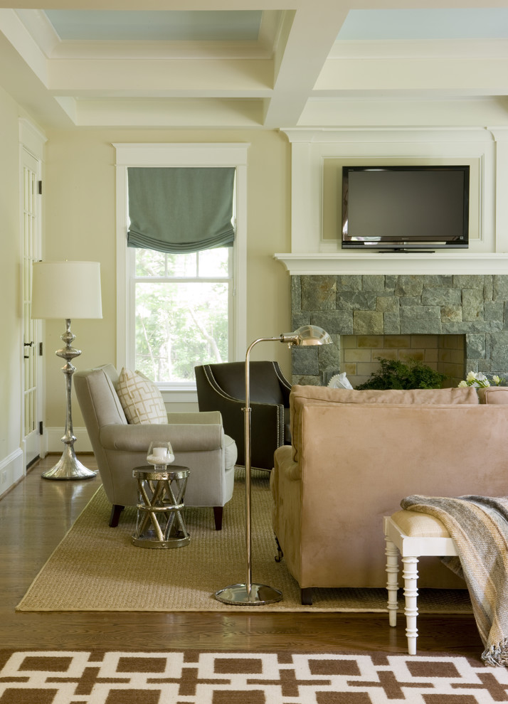 Trendy dark wood floor family room photo in DC Metro with beige walls, a standard fireplace, a stone fireplace and a tv stand