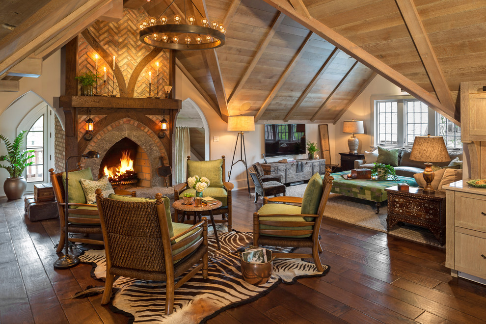 Inspiration for a small eclectic open concept family room remodel in Milwaukee with a standard fireplace