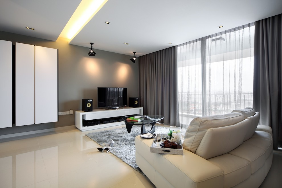 Family room - contemporary beige floor family room idea in Singapore with a tv stand and gray walls
