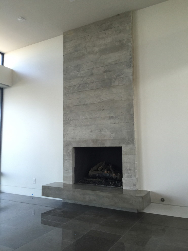 Example of a mid-sized minimalist open concept family room library design in Orange County with white walls and a standard fireplace