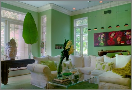 green living room with white sofa