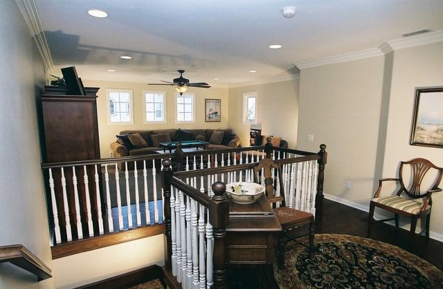 Bonus room loft addition wood railing traditional for Loft additions