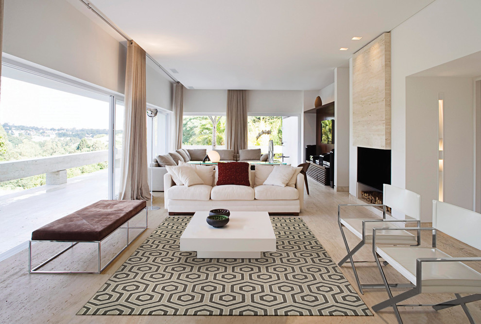 Inspiration for a contemporary open concept light wood floor and beige floor family room remodel in Boston with white walls, a ribbon fireplace and a wall-mounted tv