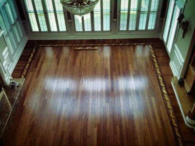 Brazilian cherry with oshkosh border floor traditional for Hardwood floors st louis