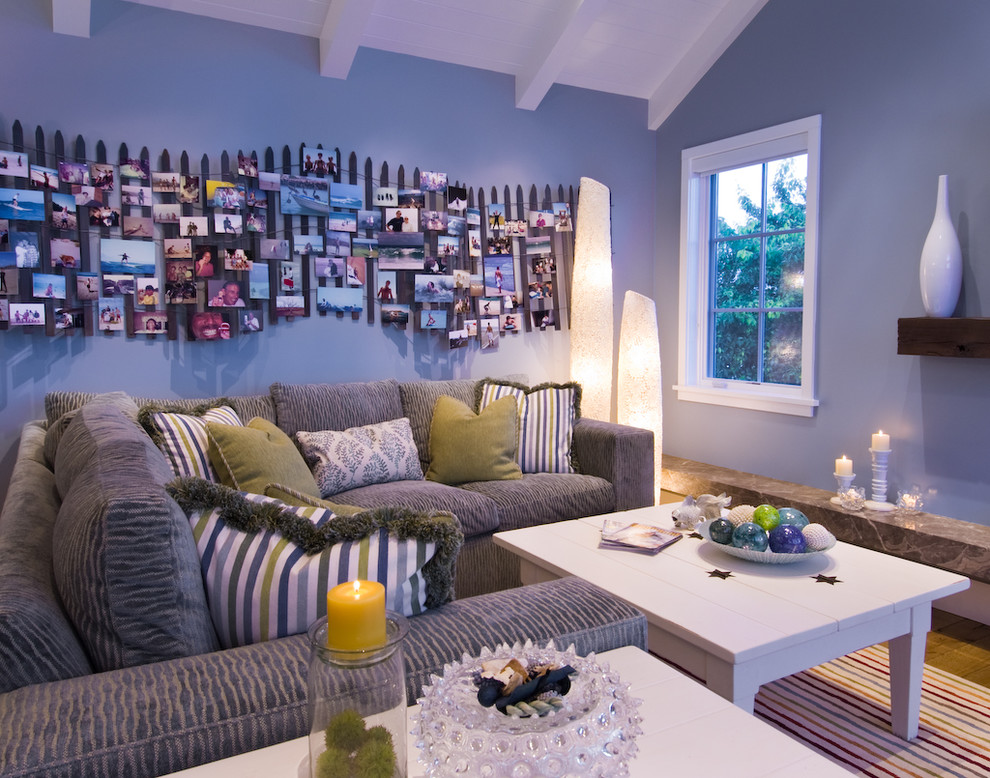 Beach style family room photo in San Francisco with blue walls