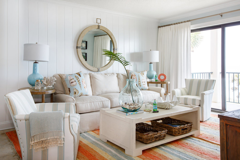 Inspiration for a coastal family room remodel in Jacksonville with white walls