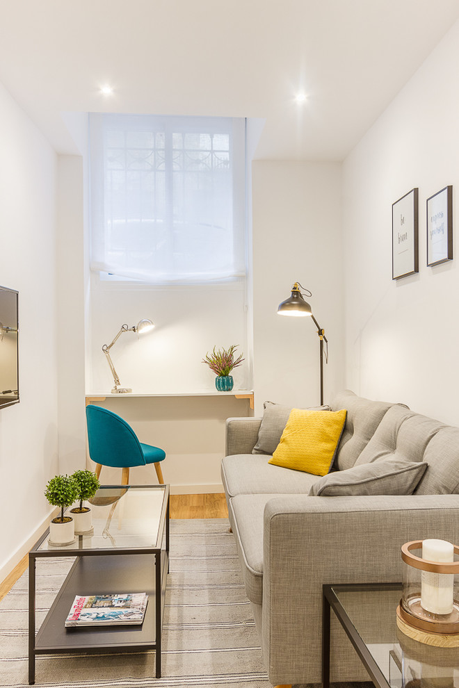 Example of a small danish family room design in Madrid with white walls, no fireplace and a wall-mounted tv