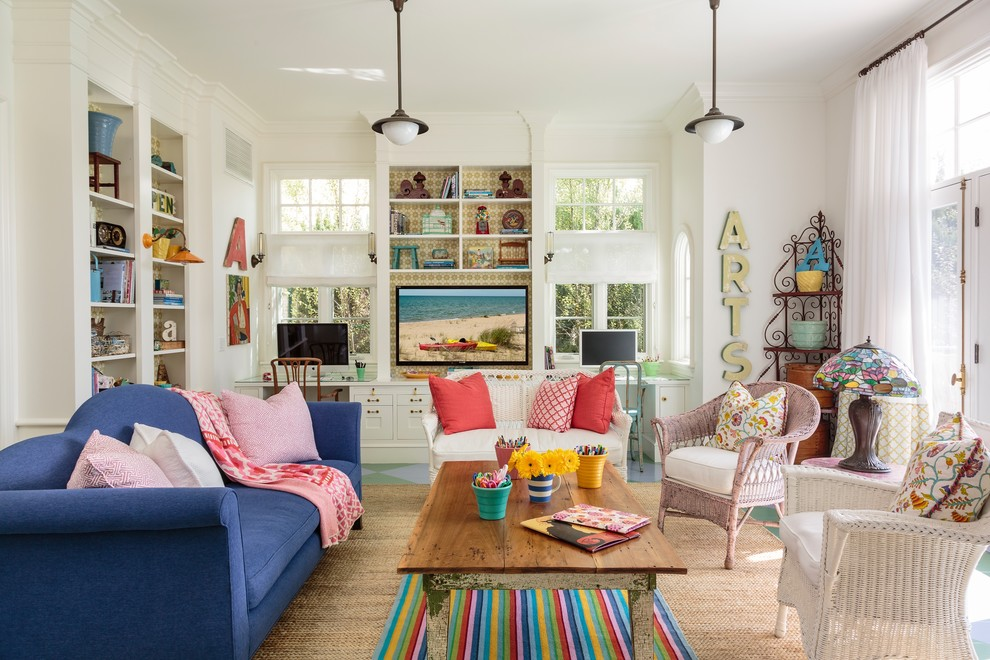 Mid-sized beach style open concept painted wood floor family room photo in Los Angeles with white walls and a media wall