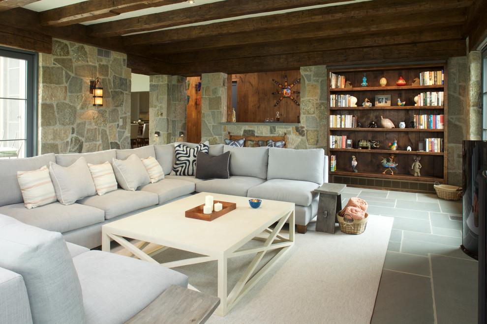 Family room - huge rustic medium tone wood floor family room idea in New York with a media wall
