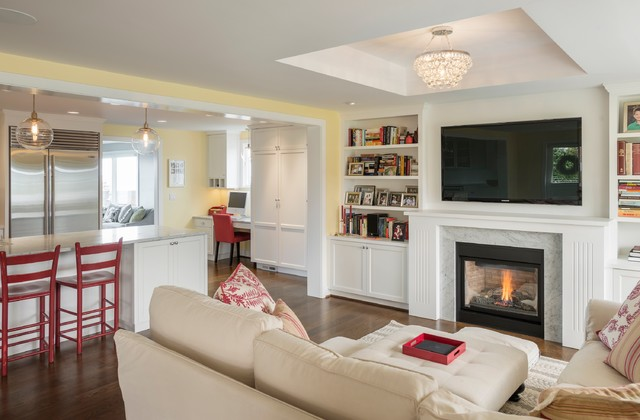 Elegant open concept dark wood floor family room photo in Seattle with yellow walls, a standard fireplace and a wall-mounted tv