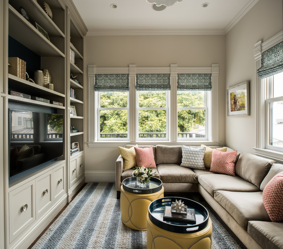 Inspiration for a timeless family room library remodel in San Francisco with beige walls, no fireplace and a media wall