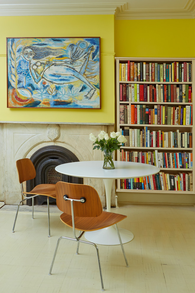 Inspiration for a transitional painted wood floor family room library remodel in New York with yellow walls, a standard fireplace and a stone fireplace