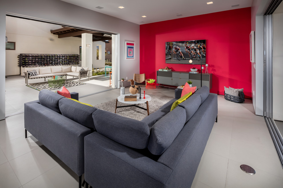 Family room - contemporary family room idea in Los Angeles with red walls