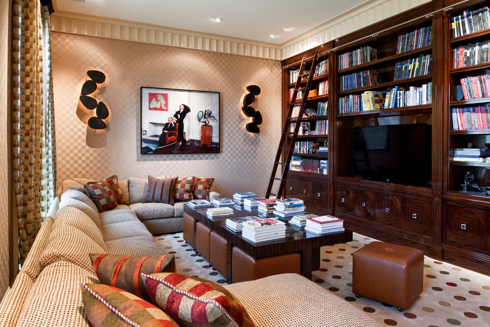 Example of a classic enclosed carpeted family room design in Philadelphia with beige walls and a media wall