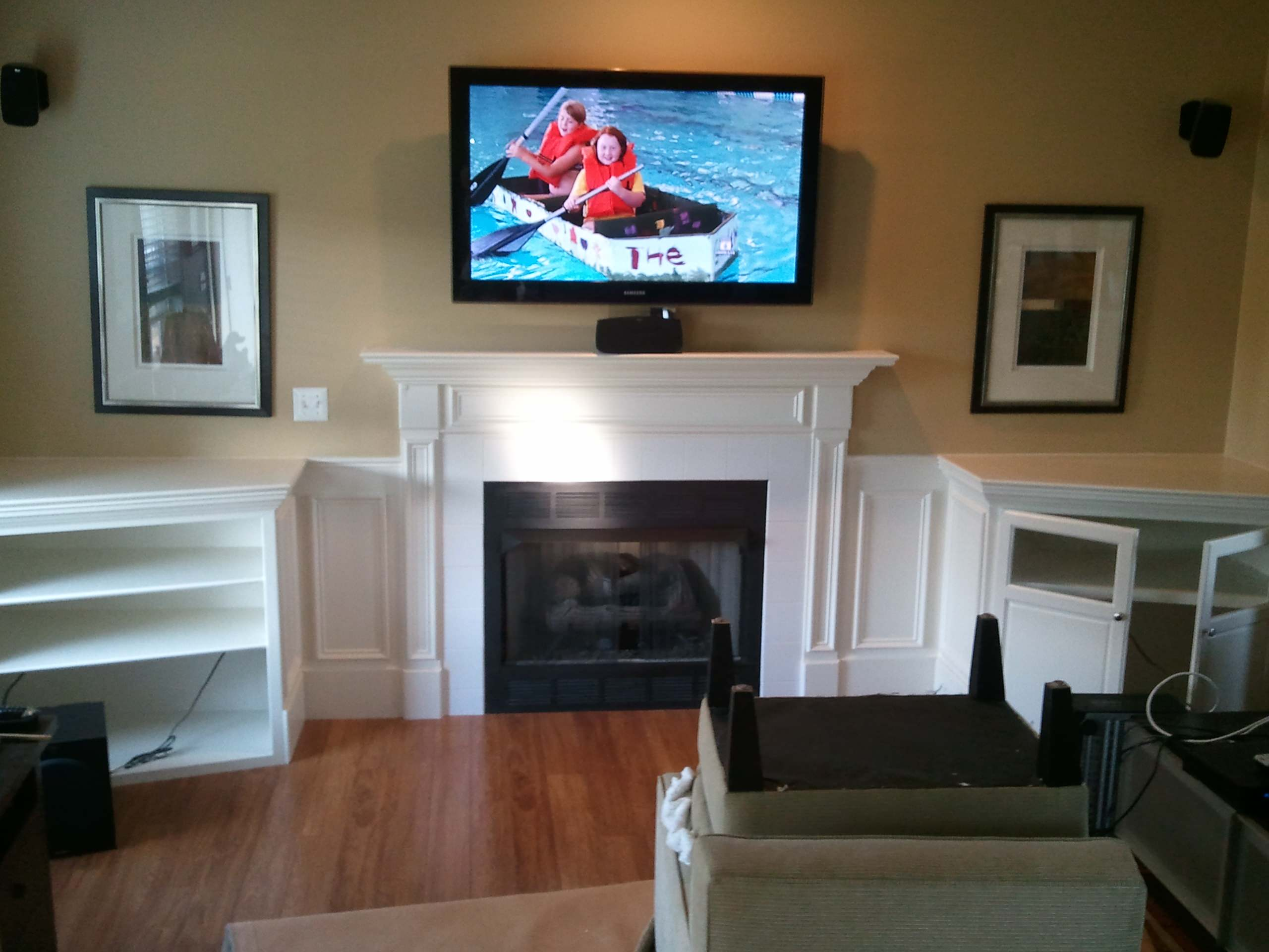 Built In Shelving and Cabinets To Hide Electronics and Surround Fireplace