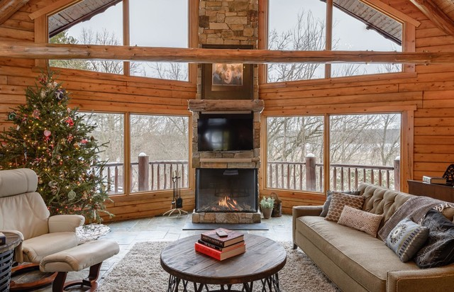 Inspiration For A Rustic Family Room Remodel In Minneapolis With Standard Fireplace Stone