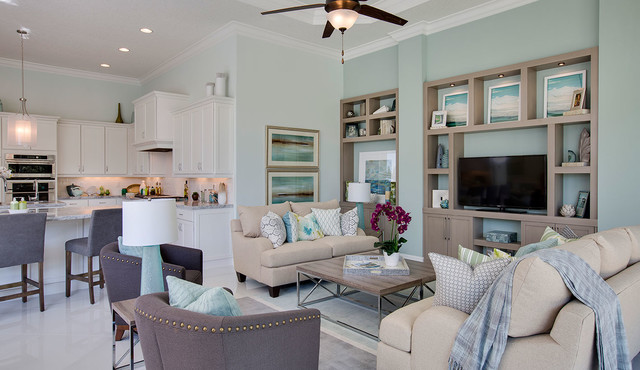 Inspiration for a beach style family room remodel in Miami with blue walls and a tv stand