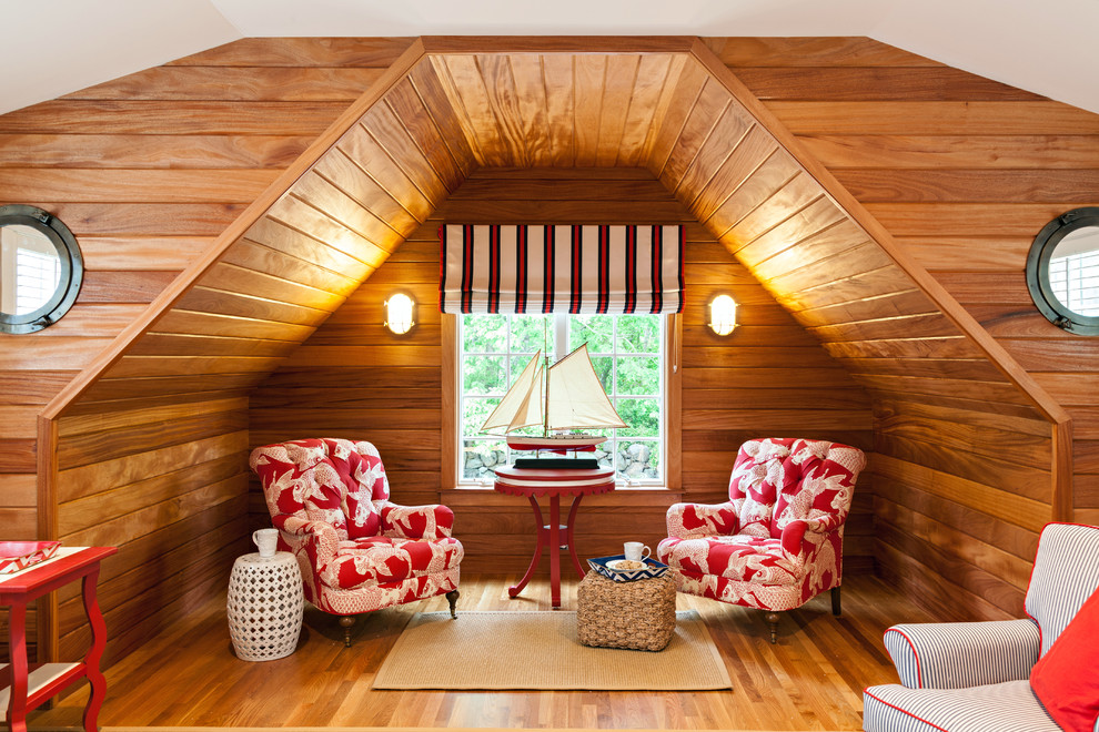 Inspiration for a coastal medium tone wood floor family room remodel in Boston