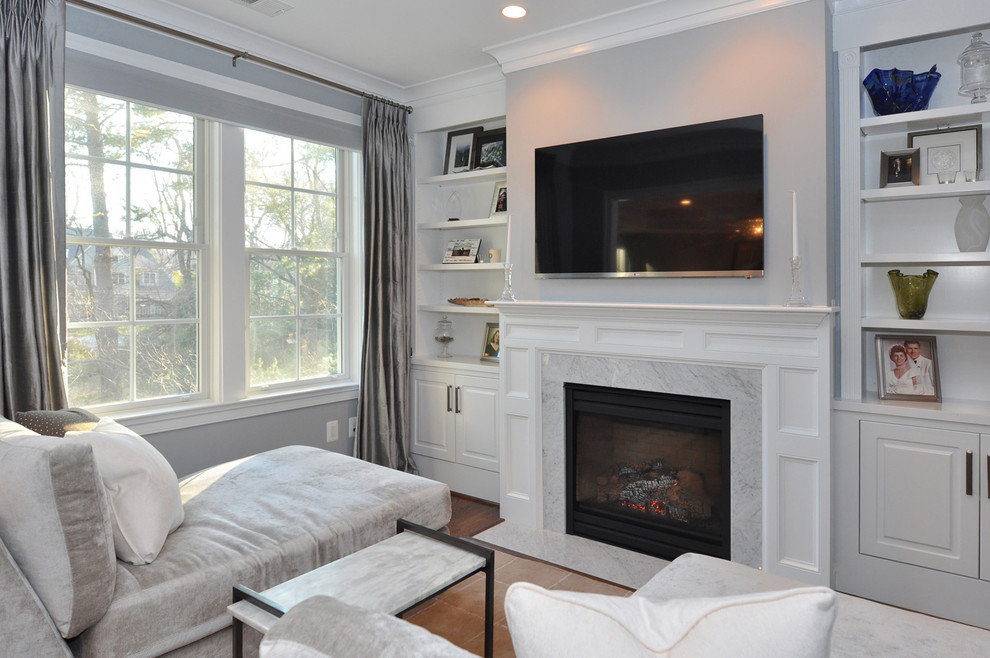 Inspiration for a timeless family room remodel in DC Metro with gray walls, a standard fireplace and a stone fireplace