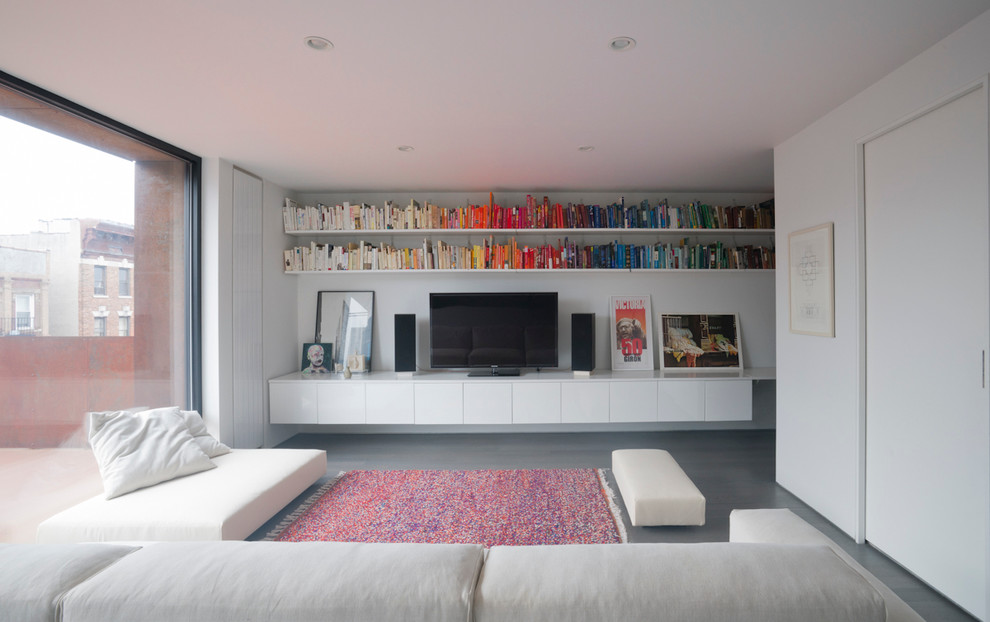 Inspiration for a mid-sized contemporary gray floor family room library remodel in New York with white walls and a tv stand