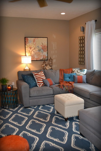 Casual orange blue and gray family room traditional for Blue and orange room