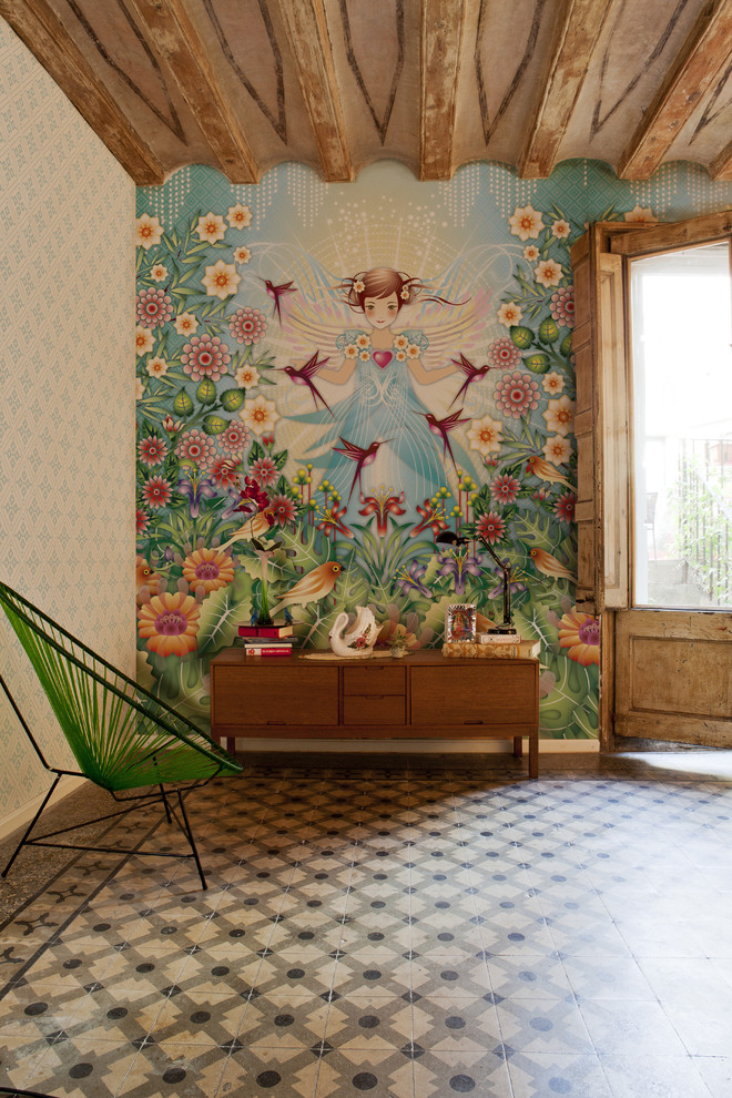Example of a mid-sized eclectic ceramic floor family room design in Barcelona with multicolored walls and no tv