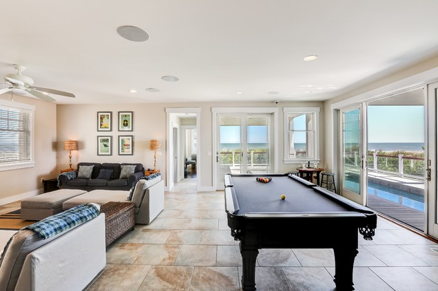 Inspiration for a mid-sized beach style enclosed porcelain floor and beige floor family room remodel in New York with beige walls