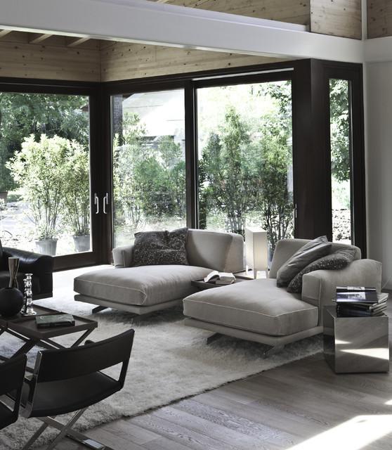 Ejemplo de sala de estar contemporánea con suelo de madera clara