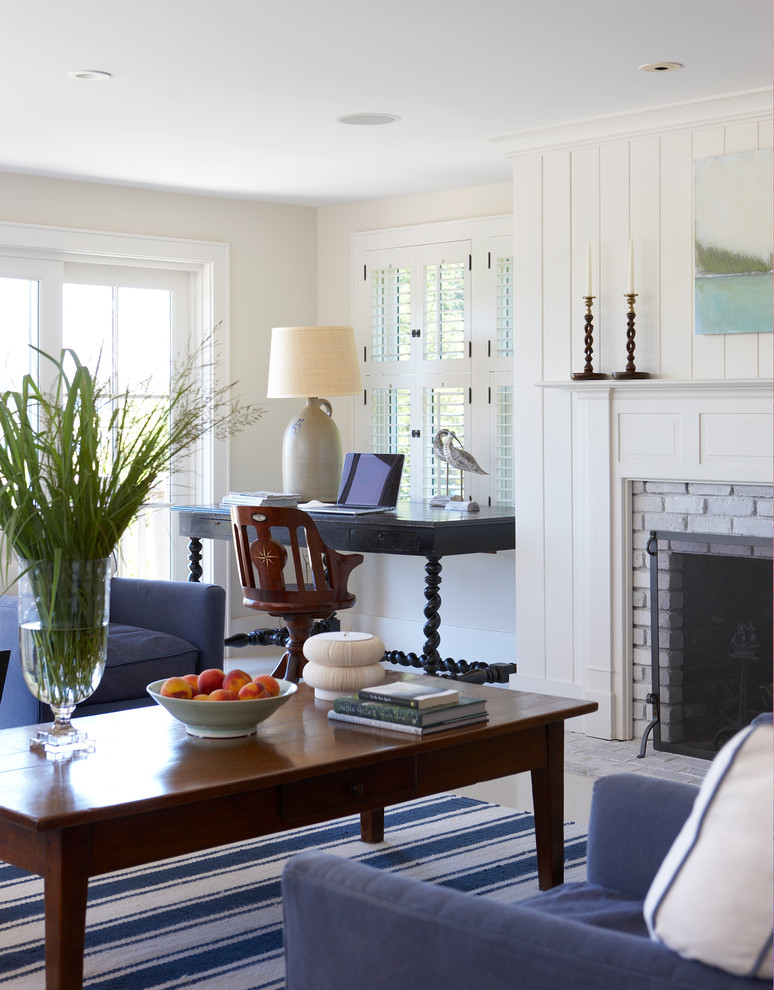 Example of a large beach style open concept porcelain tile and white floor family room design in Boston with beige walls, a standard fireplace, a brick fireplace and no tv