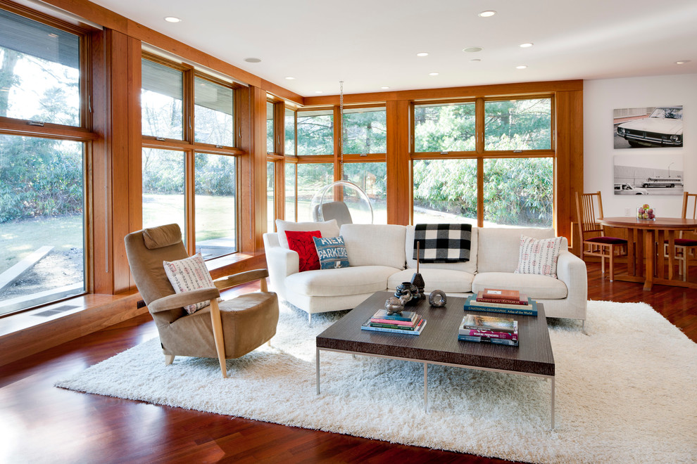 Inspiration for a contemporary open concept dark wood floor family room remodel in Boston