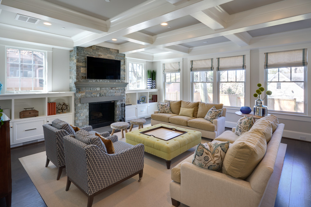 Example of a transitional dark wood floor family room design in DC Metro with white walls, a standard fireplace, a stone fireplace and a wall-mounted tv