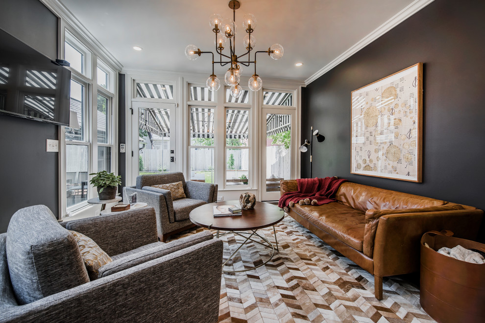 Example of a mid-sized transitional enclosed multicolored floor family room design in Columbus with black walls, a wall-mounted tv and no fireplace