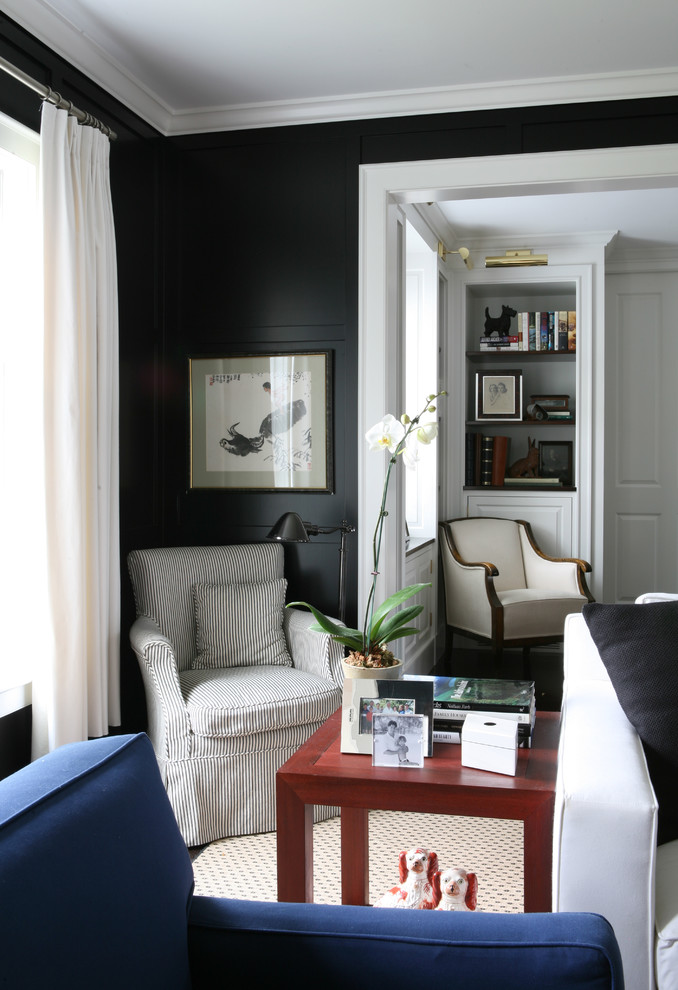 Inspiration for a victorian family room remodel in Boston with black walls
